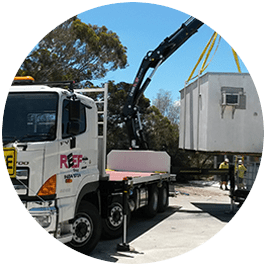 Image of our crane truck delivering a donga