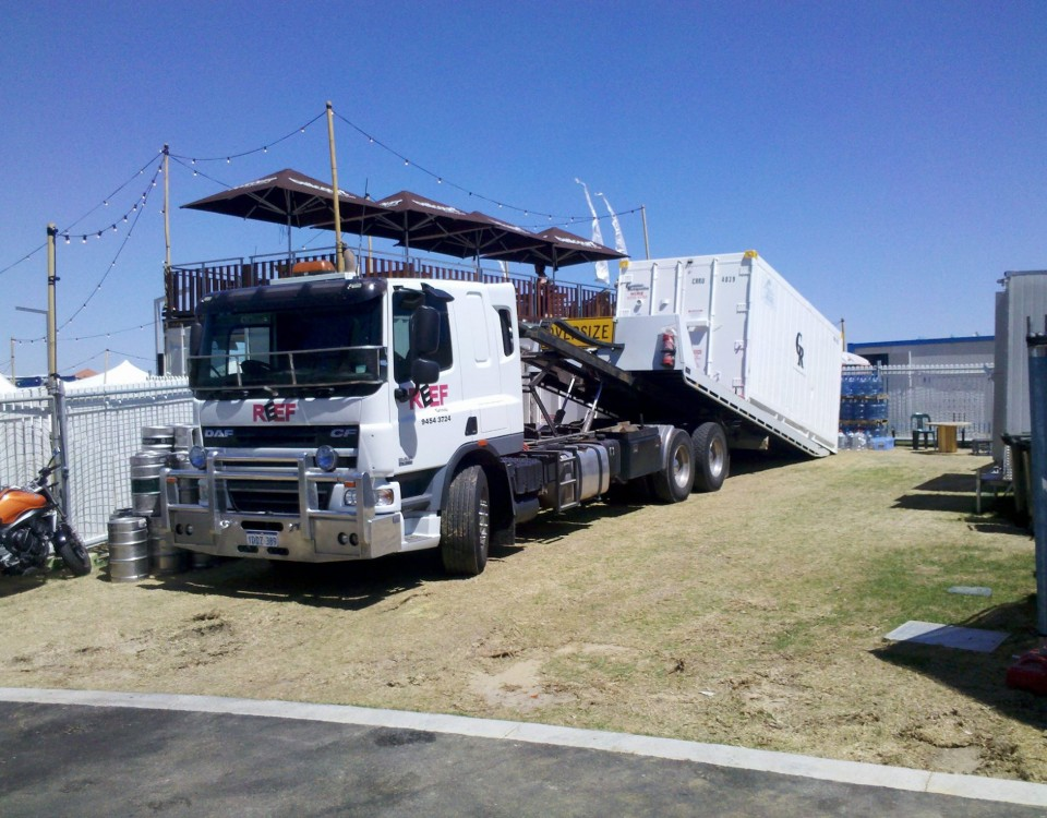 Image of tilt tray delivering a sea container for Fringe World